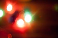 Fondo de la Navidad de la foto con las luces del color Fotos de archivo libres de regalías