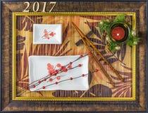 Fondo de la Navidad de la placa del sushi con el marco de la imagen Imagen de archivo