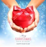 Fondo de la Navidad del día de fiesta con las manos Fotografía de archivo