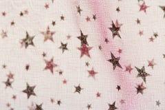 Fondo de la Navidad del grunge de la tela con el modelo de estrellas Imagenes de archivo