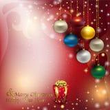 Fondo de la Navidad del resplandor con el colgante de vagos coloridos de la Navidad Foto de archivo