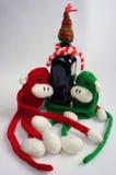 Fondo de la Navidad, mono, botella de vino, Navidad Fotografía de archivo libre de regalías