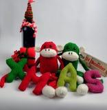 Fondo de la Navidad, mono, botella de vino, Navidad Imágenes de archivo libres de regalías