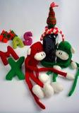 Fondo de la Navidad, mono, botella de vino, Navidad Fotos de archivo