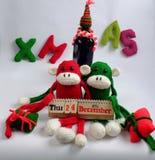 Fondo de la Navidad, mono, botella de vino, Navidad Foto de archivo libre de regalías