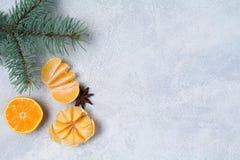Fondo de la Navidad o del Año Nuevo con los mandarines Fotografía de archivo libre de regalías