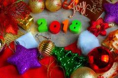 Fondo de la Navidad y del Año Nuevo con el carro de la compra miniatura w Fotos de archivo