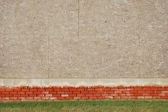 Fondo de la pared del ladrillo y de la madera contrachapada Imágenes de archivo libres de regalías
