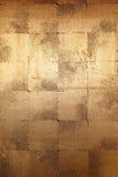 Fondo de la pared del oro Fotos de archivo