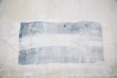 Fondo de la pared enyesada gris con el rectángulo gris para escribir los textos imágenes de archivo libres de regalías