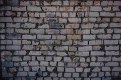 Fondo de la pared de ladrillo sucia del viejo vintage con yeso de la peladura, textura foto de archivo libre de regalías
