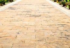 Fondo de la perspectiva: Piso de piedra de la perspectiva del ladrillo de la arena, texto Imagen de archivo libre de regalías