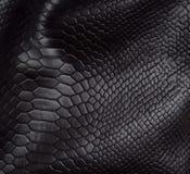 Fondo de la piel del reptil fotos de archivo