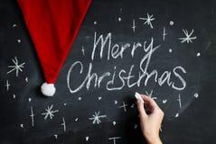 Fondo de la pizarra para la celebración de la Feliz Navidad Imagen de archivo libre de regalías