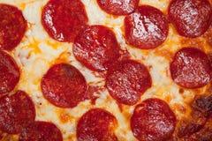 Fondo de la pizza de salchichones con queso fotos de archivo