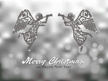 Fondo de la plata de la Feliz Navidad con ángeles Foto de archivo libre de regalías