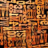 Fondo de la prensa de copiar de las letras de los números Foto de archivo libre de regalías