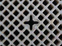 Fondo de la rejilla de la alcantarilla del hierro Foto de archivo