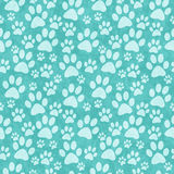 Fondo de la repetición del modelo de Teal Doggy Paw Print Tile foto de archivo