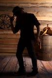 Fondo de la silla de montar del sombrero de la mano del vaquero de la silueta Fotos de archivo