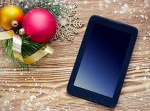 Fondo de la tableta de la PC del día de fiesta de Navidad Fotos de archivo libres de regalías