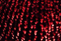 Fondo de la tarjeta del día de San Valentín de la forma del corazón de Bokeh imagen de archivo