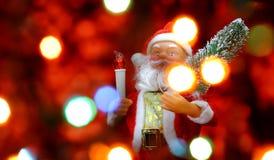 Fondo de la tarjeta del ` s del Año Nuevo con Santa Claus Foto de archivo