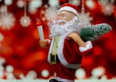 Fondo de la tarjeta del ` s del Año Nuevo con Santa Claus Imagen de archivo