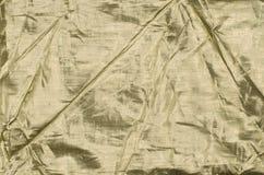 Fondo de la tela del oro Fotografía de archivo