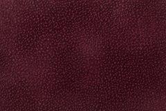 Fondo de la tela rojo oscuro adornado con el animal de la capa Imagen de archivo libre de regalías