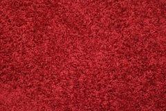 Fondo de la textura de la alfombra roja Imágenes de archivo libres de regalías