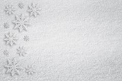 Fondo de la textura de la nieve con los copos de nieve Fotos de archivo