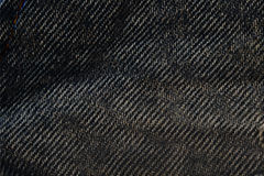 Fondo de la textura de la tela de Jean, una cierta pieza de la cacerola azul corta de la mezclilla imágenes de archivo libres de regalías