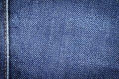 Fondo de la textura de la tela de los vaqueros del dril de algodón con la costura para el diseño Foto de archivo
