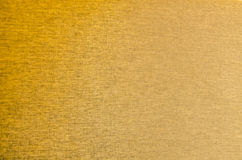 Fondo de la textura de la tela del color oro Imágenes de archivo libres de regalías