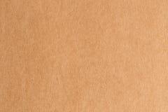 Fondo de la textura del extracto de la cartulina de Brown Foto de archivo libre de regalías