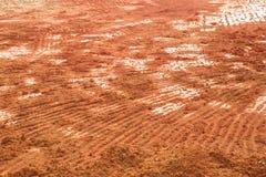 Fondo de la textura del suelo de la naranja o de Brown Prepárese para el agricultur Fotos de archivo