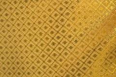 Fondo de la textura de la tela del oro imagenes de archivo