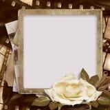 Fondo de la vendimia con la tira del foto-marco y de la película Imagen de archivo libre de regalías