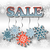 Fondo de la venta del invierno con los copos de nieve brillantes Fotografía de archivo libre de regalías
