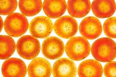 Fondo de la zanahoria en blanco con el contraluz/la macro Fotos de archivo libres de regalías