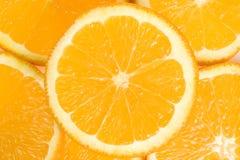 Fondo de las naranjas del corte Imágenes de archivo libres de regalías