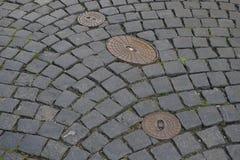 Fondo de las piedras del pavimento en Praga Foto de archivo libre de regalías