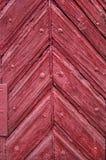 Fondo de las puertas viejas hechas de la madera roja fotografía de archivo libre de regalías
