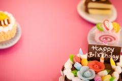 Fondo de las tortas de cumpleaños Imagen de archivo libre de regalías
