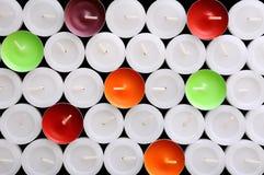 Fondo de las velas de diversos colores Imágenes de archivo libres de regalías