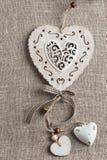 Fondo de lino con los corazones de Navidad Fotos de archivo