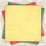 Fondo de lino con un papel multicolor Imagenes de archivo