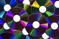 Fondo de los Cdes/de DVDs Imágenes de archivo libres de regalías