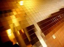 Fondo de los cuadrados de bronce Fotos de archivo libres de regalías